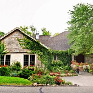 Beautiful rambler home located on an acre and a half of wooded land surrounded by gardens.